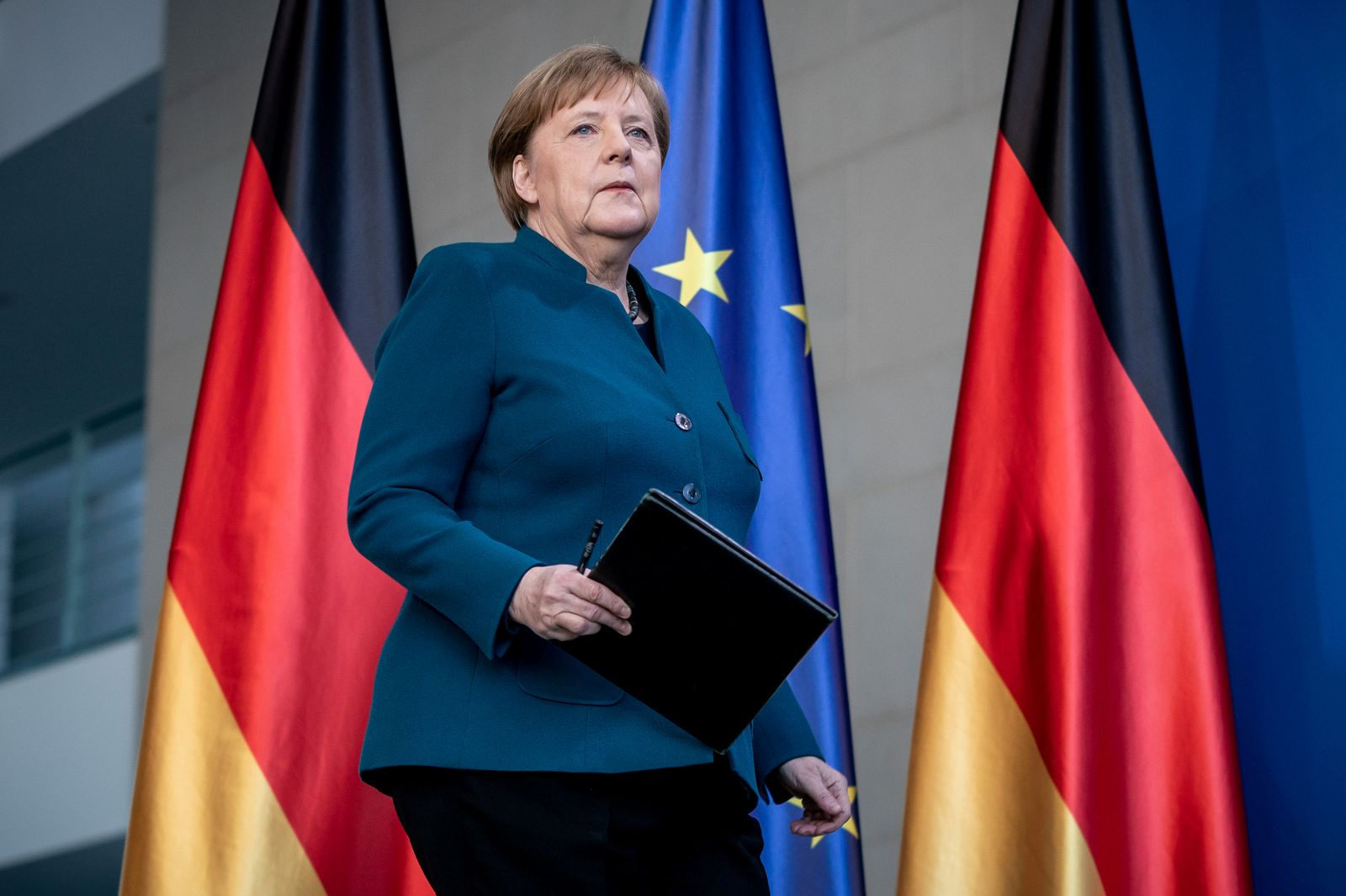 German Chancellor Angela Merkel arrives for a media statement on the spread of coronavirus at the Chancellery in Berlin, Germany