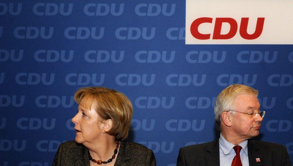 """Kanzlerin Merkel, Ministerpräsident Koch: """"Über unsere Verhältnisse"""""""