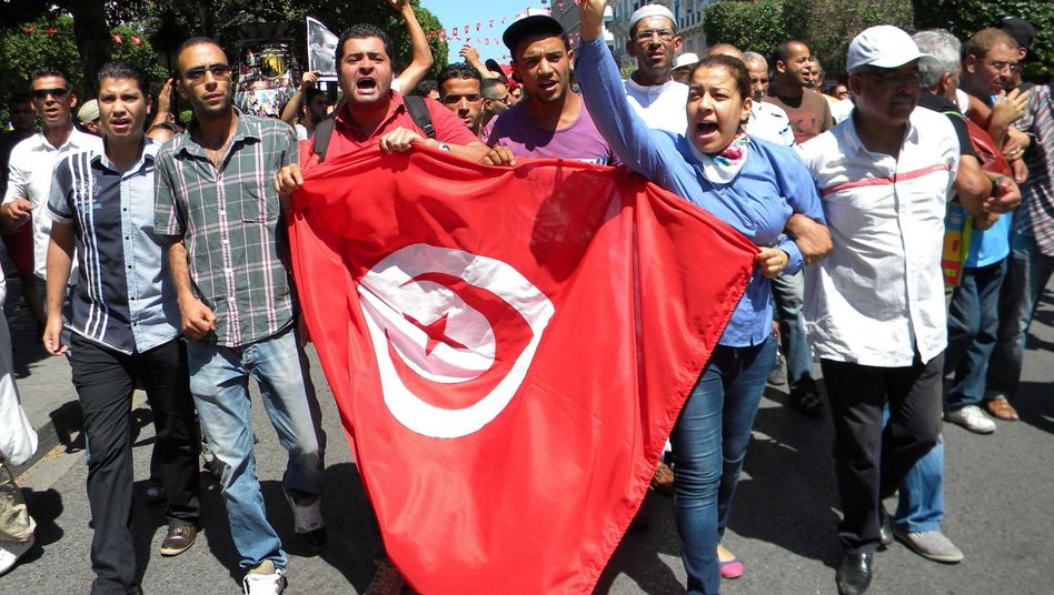 Tunisians demonstrate against the killing of opposition politician Mohamed Brahmi in Tunis on July 25.