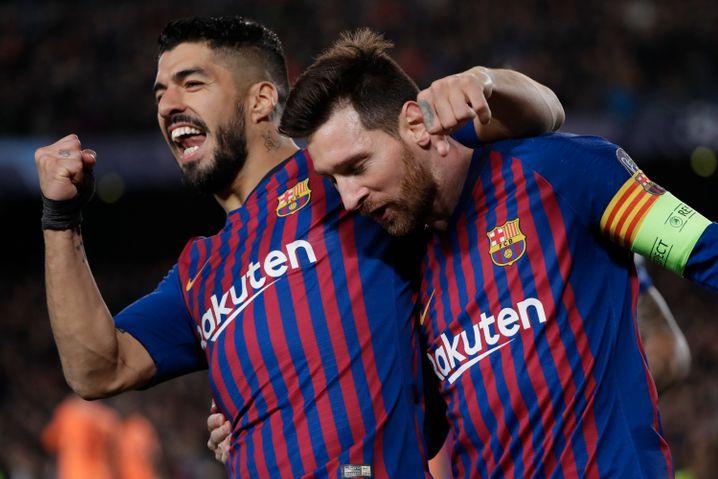 Unzertrennlich auch abseits des Platzes: Suárez und Lionel Messi (r)