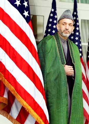 """Afghanistans Staatschef Karsai (in Washington): """"Die Ölkonzerne werden nicht auf sich warten lassen"""""""