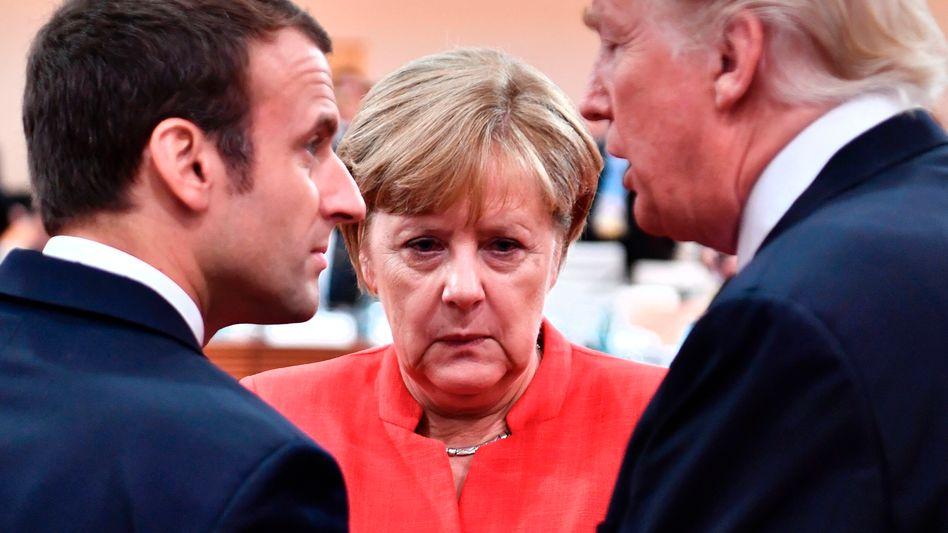 Emmanuel Macron, Angela Merkel und Donald Trump (Archivbild)