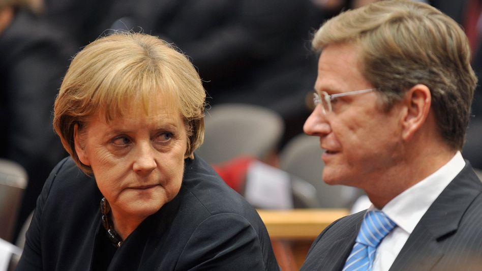 CDU-Chefin Merkel, FDP-Vorsitzender Westerwelle: Marathonsitzung mit vielen Problemen