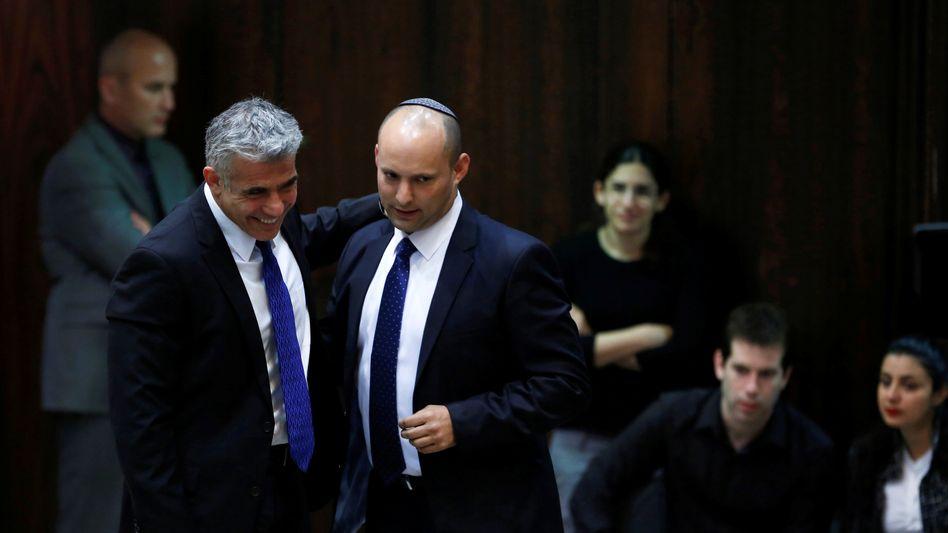 Parteiführer Naftali Bennett (r.) und Jair Lapid: Vorstoß von epochaler Bedeutung