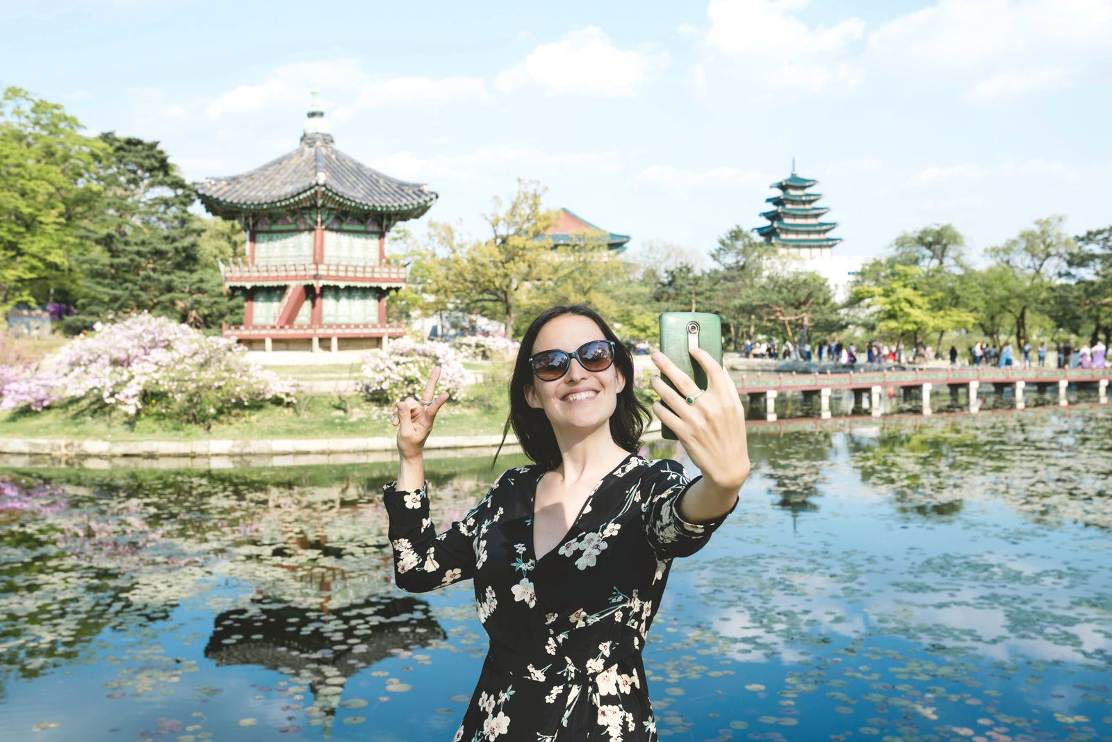 South Korea Seoul Woman taking a selfie with smartphone at Gyeongbokgung Palace model released Symbo