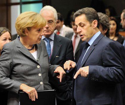 Kanzlerin Merkel, Präsident Sarkozy (bei Krisengipfel im Dezember 2008): Streit um den Protektionismus