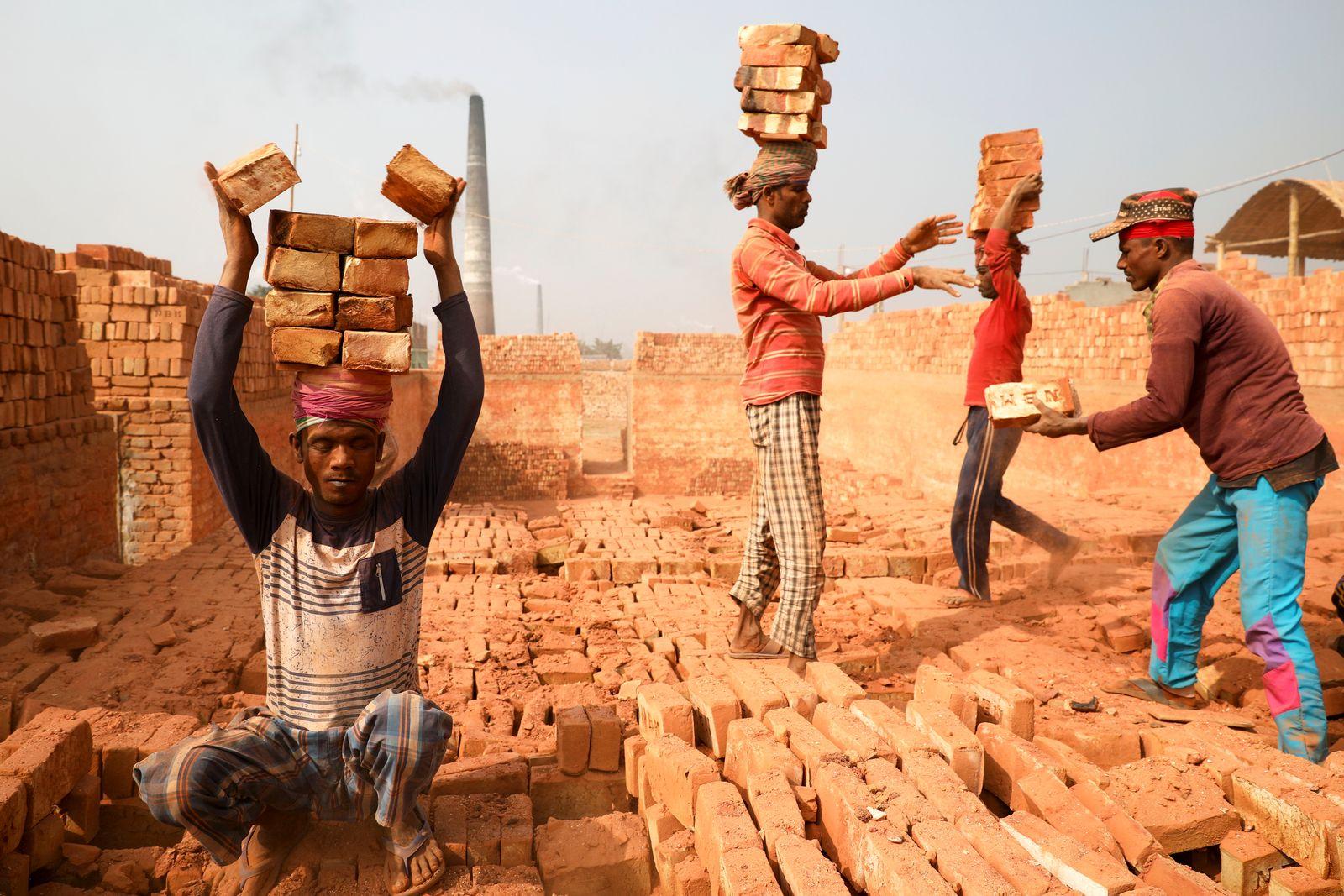 People are working in a brick kiln in Narayanganj