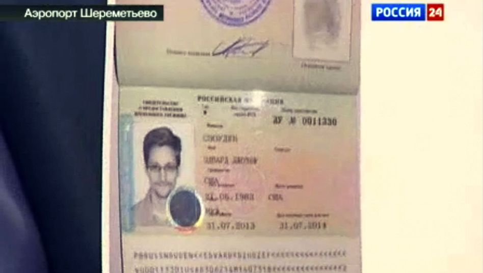A television screenshot shows Edward Snowden's new Russian travel document.