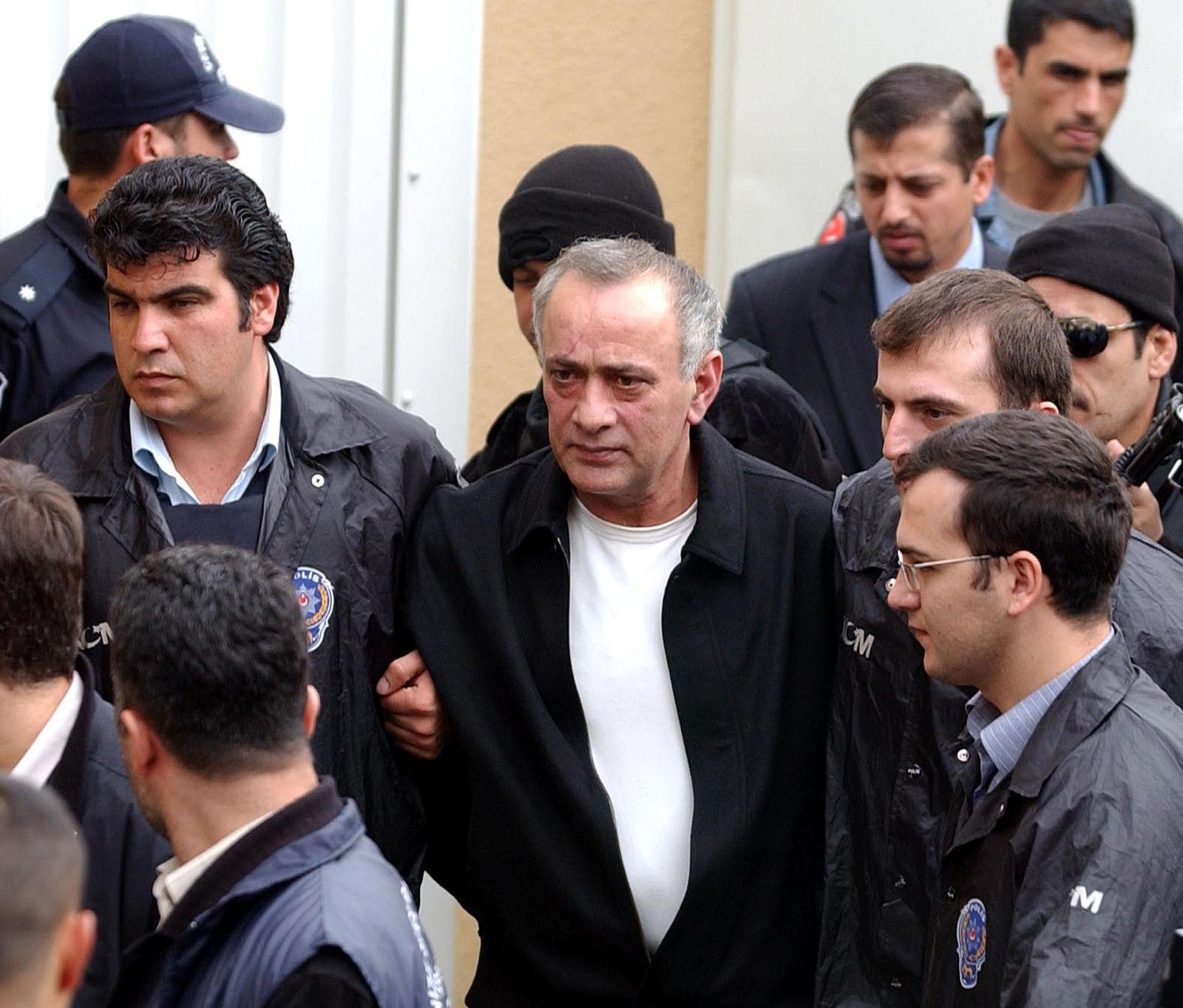 Convicted Turkish underworld boss Alaattin Cakici arrives at a Turkish court in Istanbul.
