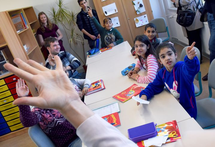 Refugee children receive instruction at an elementary school in Potsdam.