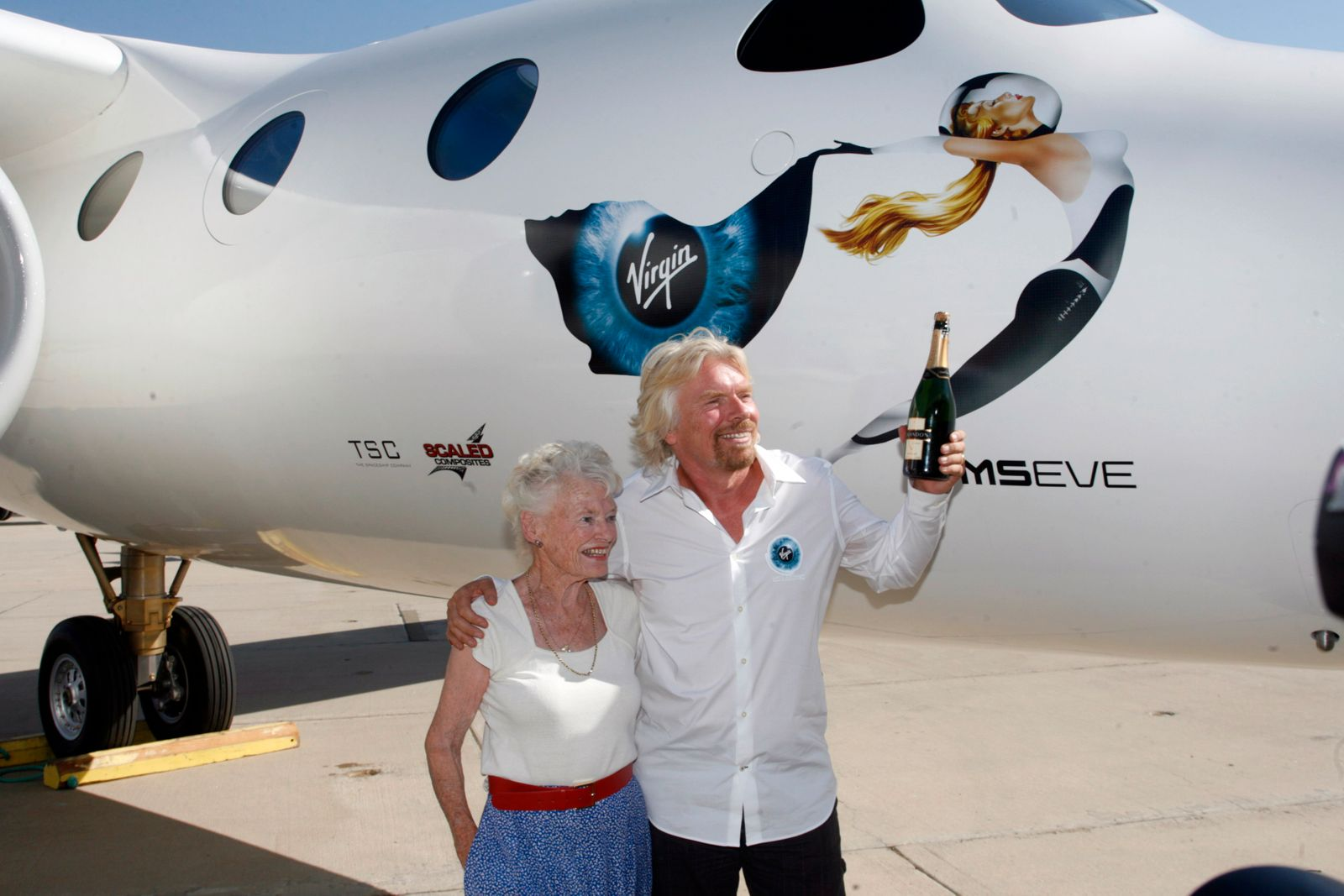 Richard Branson prepares to christen Virgin Galactic's mothership WhiteKnightTwo in honor of his mother during its public roll-out in California