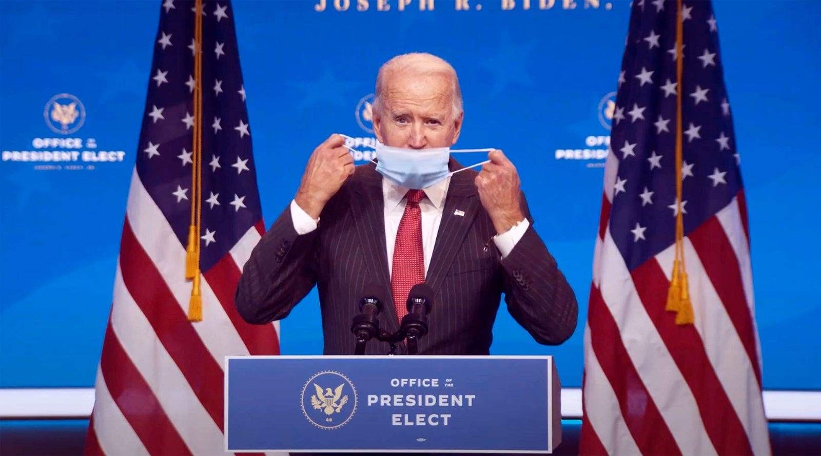 November 19, 2020, Wilmington, Delaware, USA: United States President-elect Joe Biden removes his mask prior to making