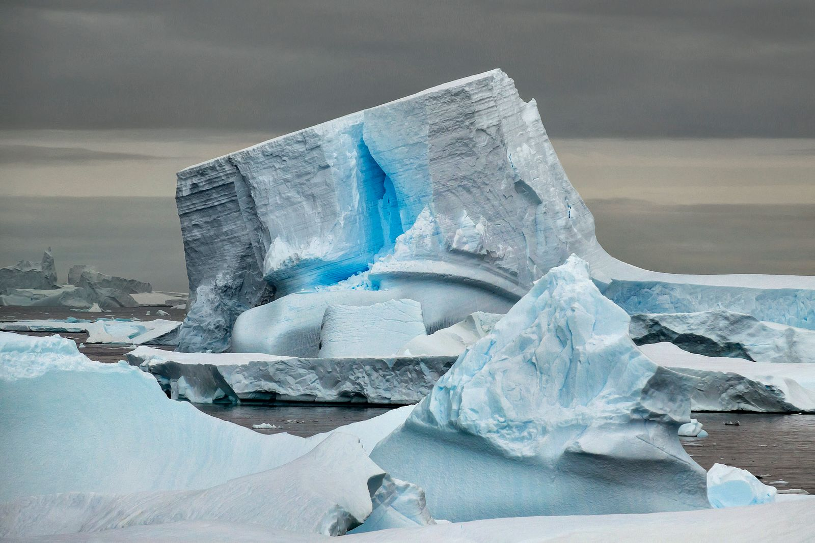 Unique iceberg with blue crack along the waters of the Antarctic Peninsula. (Larry Malvin)