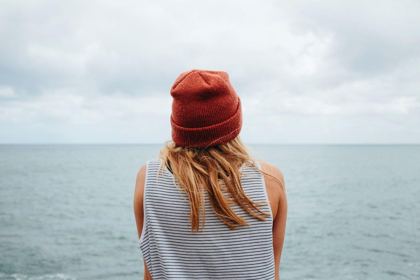 Woman Overlooking The Ocean.