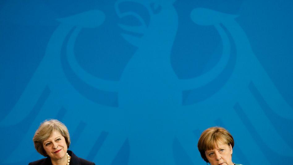 Premierministerin May, Kanzlerin Merkel