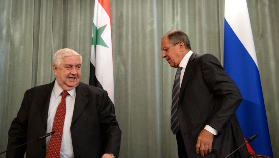 Syriens Außenminister Walid al-Muallim und Russlands Außenminister Lawrow (r.): Plan angekündigt