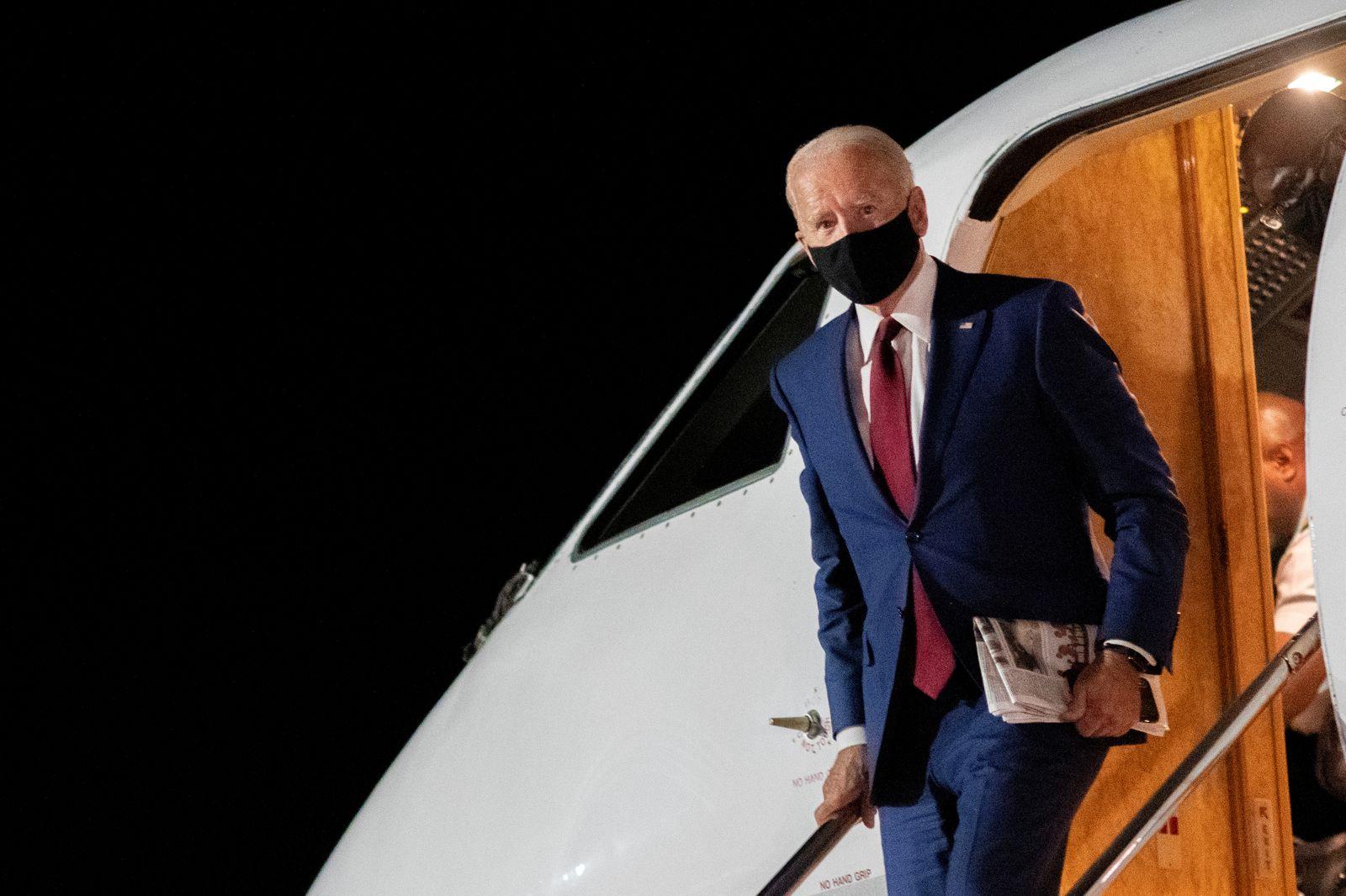 Democratic U.S. presidential nominee Joe Biden disembarks plane in New Castle, Delaware