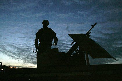 A US soldier in Iraq prepares to go on patrol.