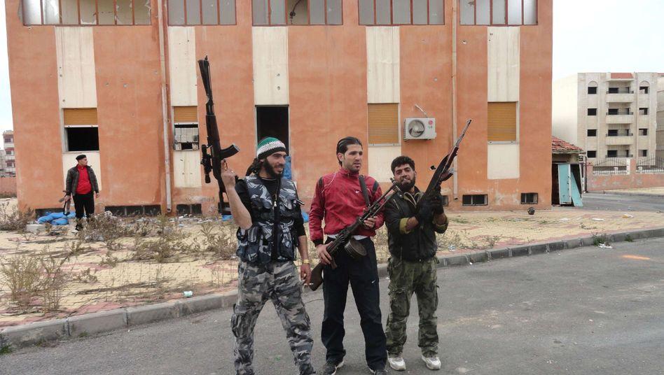 Rebellen in der syrischen Protesthochburg Homs: US-Militäraktion gegen AssadsRegime?