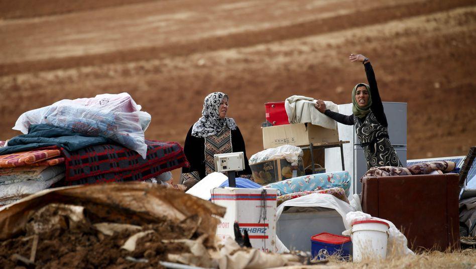 Beduinen mit ihren Habseligkeiten