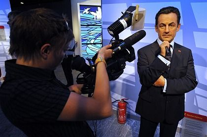 Le télépresident: French President Nicolas Sarkozy, in wax, at Berlin's new Madame Tussaud's.
