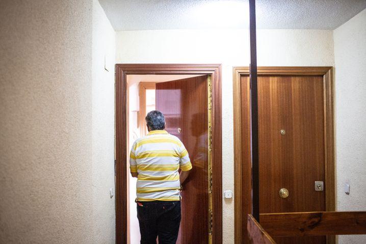 Zuleta walks into his new apartment in Mostoles.
