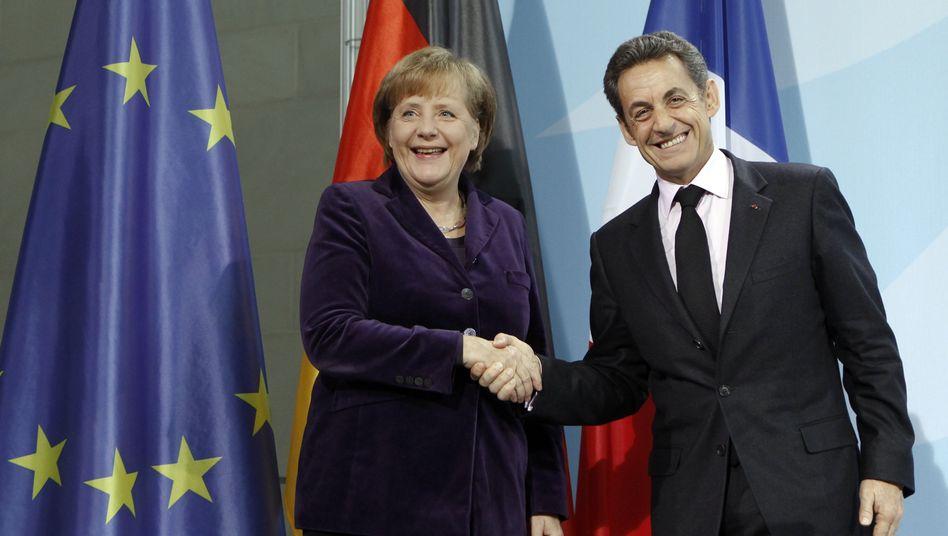 Nicolas Sarkozy und Angela Merkel: Betonen der Gemeinsamkeiten