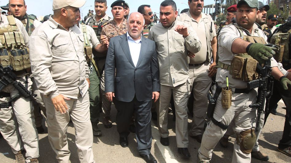 Iraqi Prime Minister Haidar al-Abadi (center) visits Tikrit on Wednesday a day after he declared victory in the weeks-long battle to retake the city from the Islamic State.