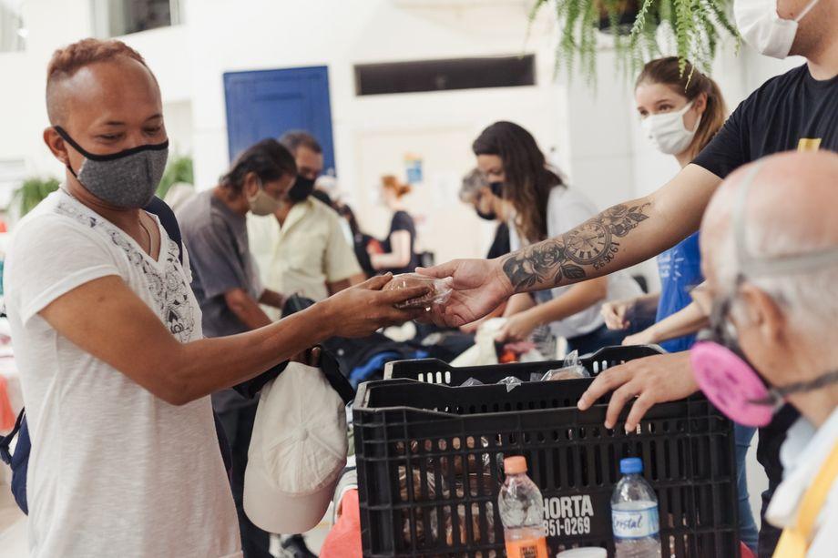 Volunteers distributing food to those in need