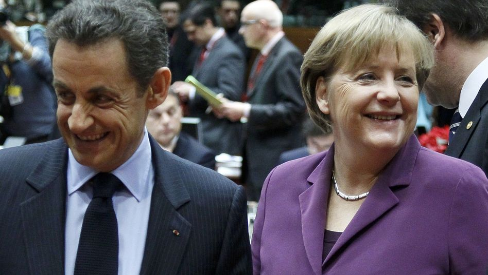 French President Nicolas Sarkozy and German Chancellor Angela Merkel in Brussels: Merkel and Sarkozy can't be pleased with the outcome either.