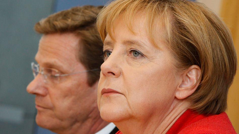 CDU-Chefin Merkel, FDP-Chef Westerwelle: Ansehensverlust durch ständige Querelen
