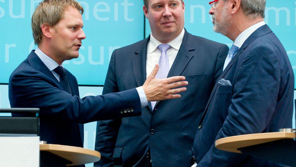 Aktionsplan: Gesundheitsminister Bahr (links) bei der Vorstellung in Berlin