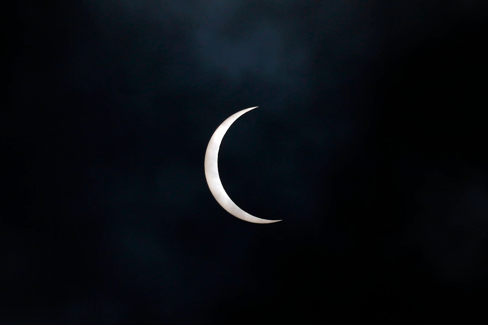 June 21, 2020, Kathmandu, Nepal: The celestial partial solar eclipse appears in the sky pictured from Kathmandu, Nepal