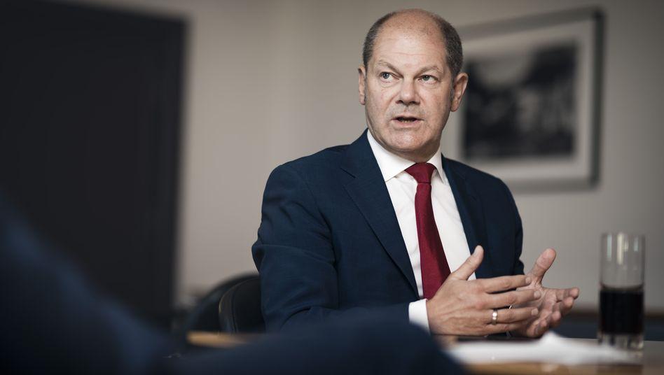 """Finanzminister Olaf Scholz: """"Inzwischen sind das im gesamten Etat mehr als 15 Milliarden Euro"""""""
