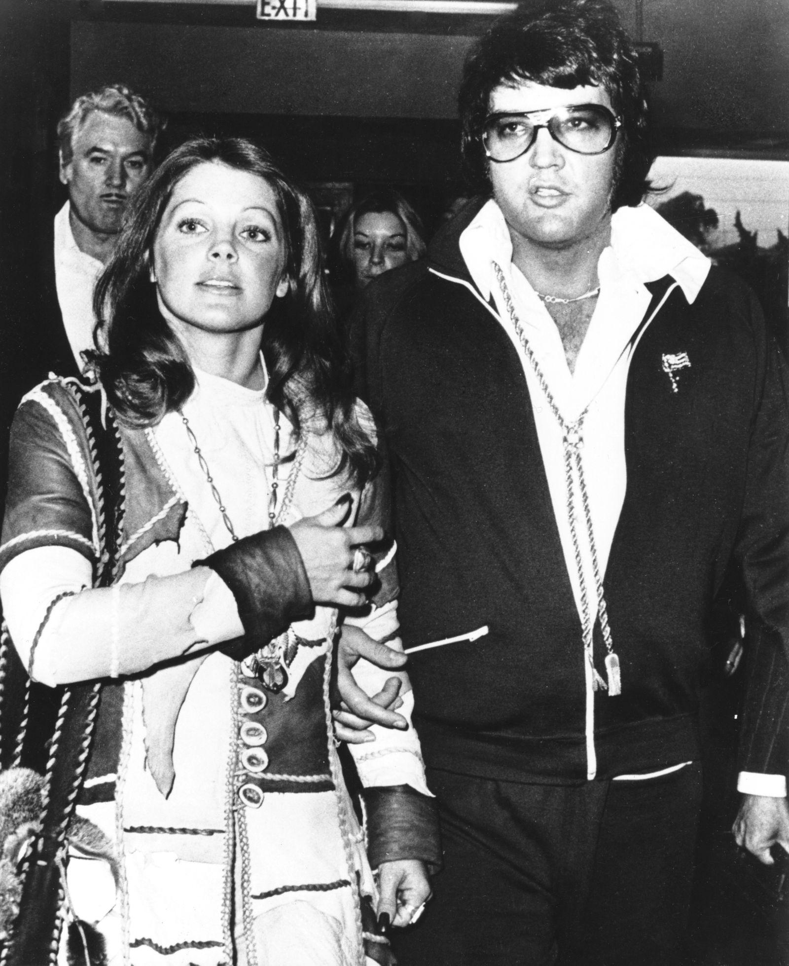 Elvis Presley and Priscilla at their divorce hearing