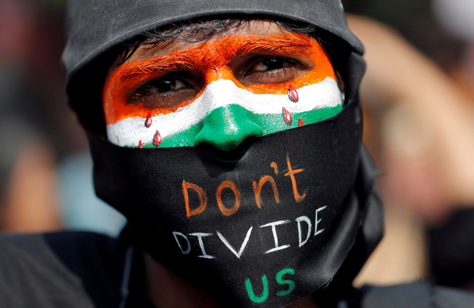 A demonstrator attends a protest against riots following clashes between people demonstrating for and against a new citizenship law in New Delhi