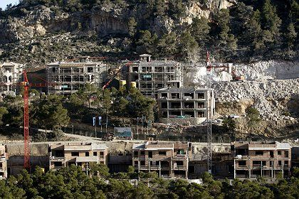 Houses under construction in Cala Moragues in Andratx on the southwest coast of Mallorca. The real estate sector in Spain is riddled with corruption.