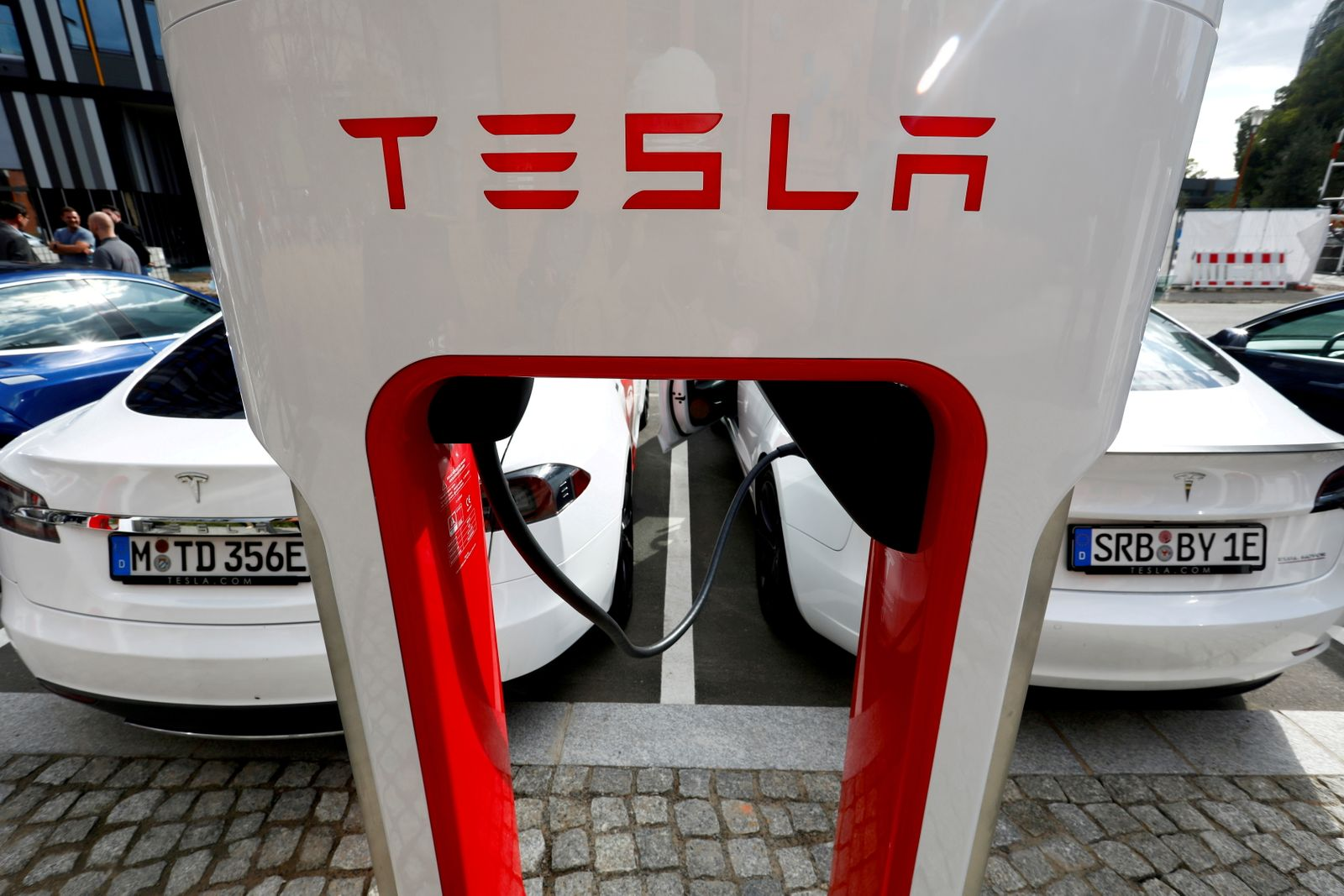 FILE PHOTO: Tesla managers demonstrate V3 superchargers on German research campus in Berlin