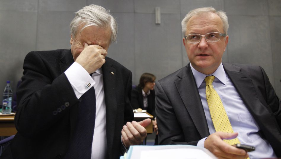 ECB President Jean-Claude Trichet, left, and European Commissioner for the Economy Olli Rehn in Luxembourg on Sunday night.