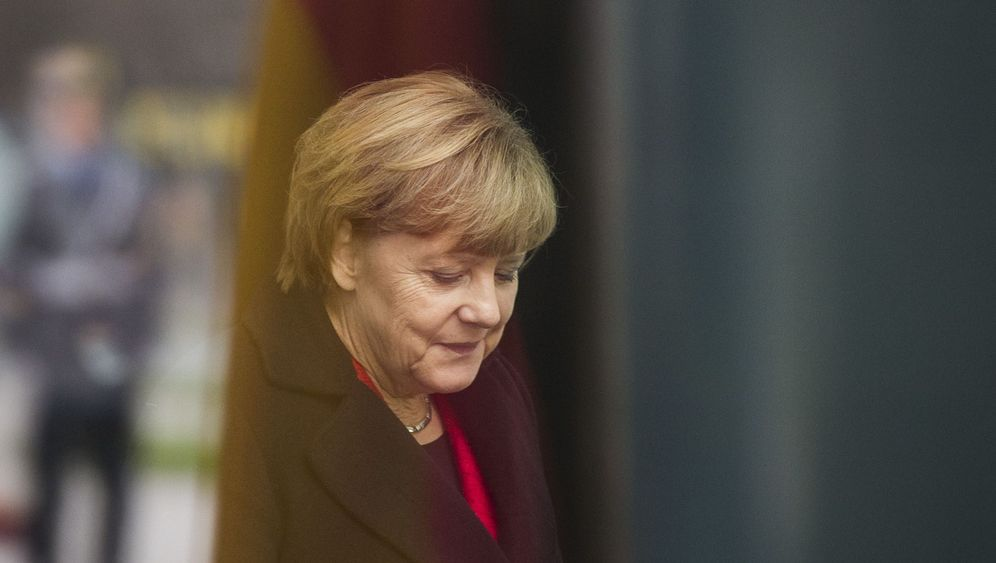 Photo Gallery: Merkel Changes Strategy on Refugees