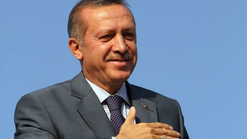Turkish Prime Minister Recep Tayyip Erdogan arrives in Turkish-held northern Cyprus on Tuesday.