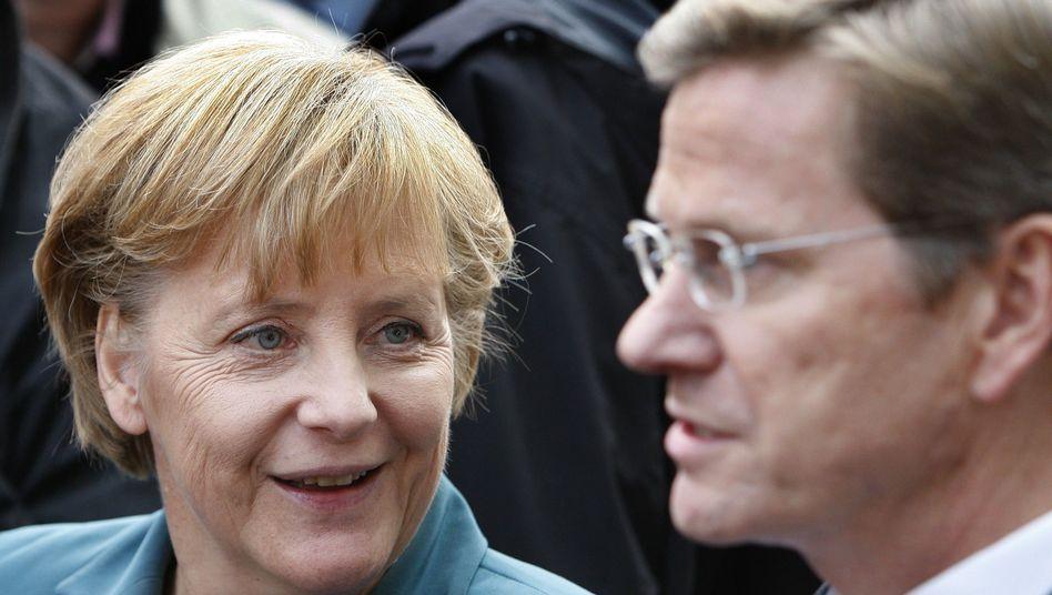 """Kanzlerin Merkel, Koalitionspartner Westerwelle: """"Wir wollen eine EU, die eine aktive Rolle in der Welt spielt"""""""