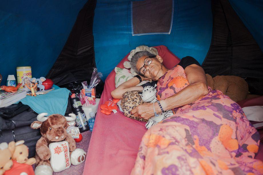 Elvira Ferreira da Silva keeps her tent clean and neat.