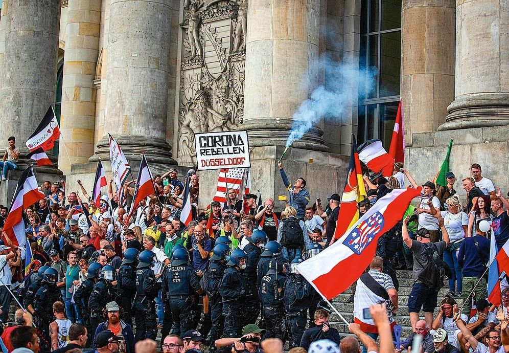 "A mob flying the so-called ""Reichsflagge"" on the steps of German parliament on August 29, 2020."
