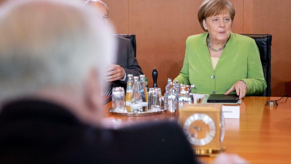 CSU-Politiker Seehofer (vorne von hinten) und CDU-Politikerin Merkel