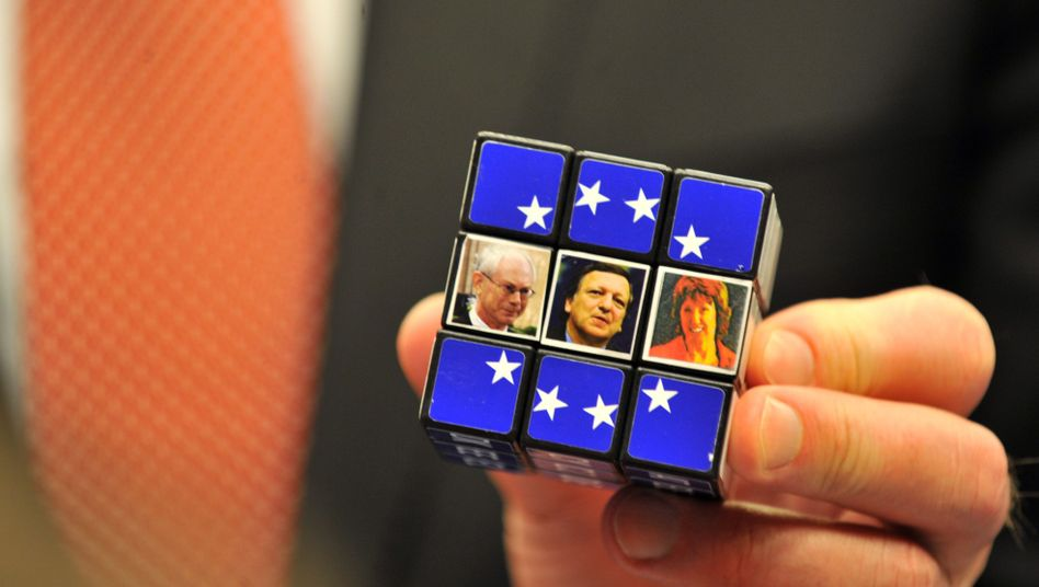 A Rubik's cube with photos of (from left) Herman Van Rompuy, the European Union's first president, European Commission President Jose Manuel Barroso and the EU's new foreign minister, Catherine Ashton.