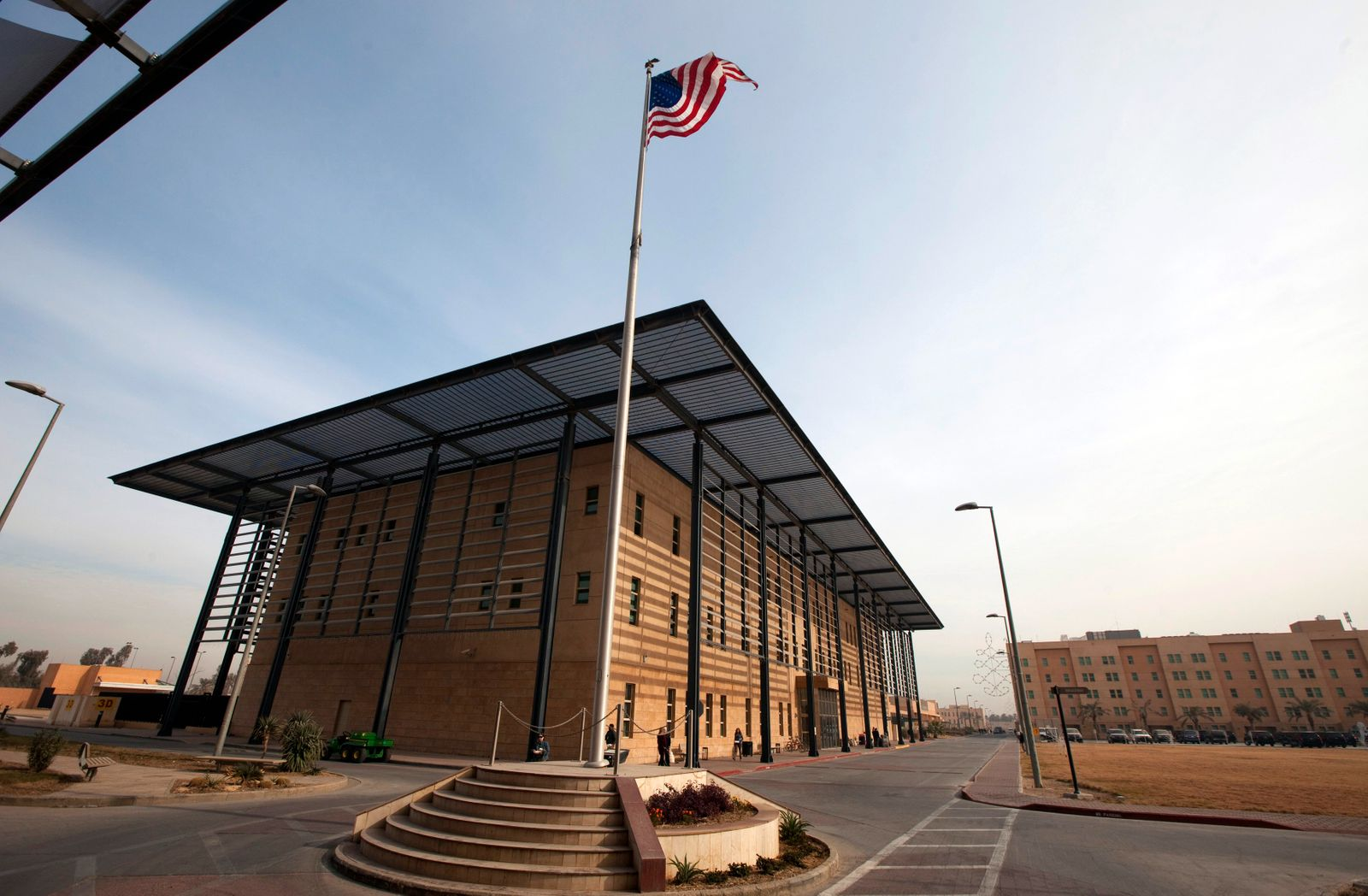 File photo of a U.S. flag flying in front of the Annex I building inside the compound of the U.S. embassy in Baghdad