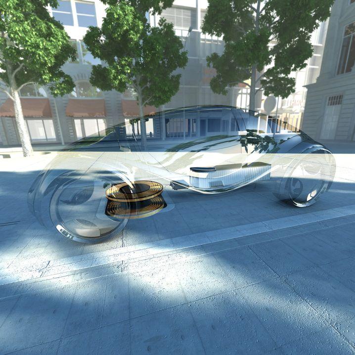 Über Spulen im Boden lassen sich Elektrofahrzeuge kabellos aufladen. Das soll künftig auch während der Fahrt funktionieren.