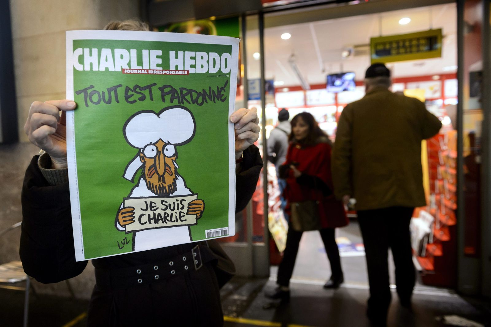 Charlie Hebdo in front of a news stand in Lausanne