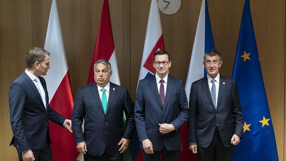 Regierungschefs Igor Matovic (Slowakei), Viktor Orbán (Ungarn), Mateusz Morawiecki (Polen), Andrej Babis (Tschechien): Sieg über die Verteidiger des Rechtsstaats